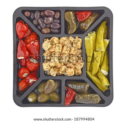 Antipasti platter with vegetables, feta cheese and spices isolated on white background