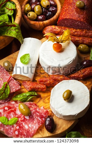 Antipasto catering platter with different meat and cheese products - stock photo