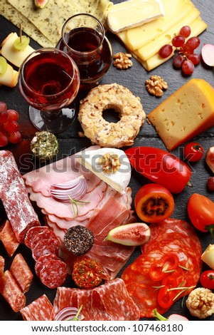Antipasto catering platter with red wine - stock photo