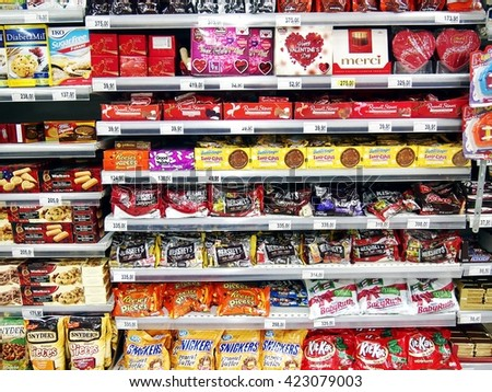 ANTIPOLO CITY, PHILIPPINES - APRIL 18, 2016: A variety of imported and local chocolate bars and candies on display at a grocery store in Antipolo City, Philippines