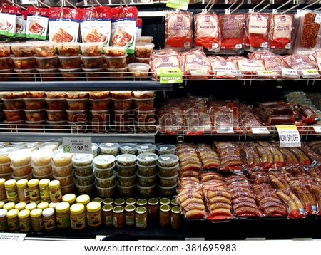 ANTIPOLO CITY, PHILIPPINES - FEBRUARY 10, 2016: A variety of choice meat cold cuts on a freezer shelf of a grocery store in Antipolo City, Philippines