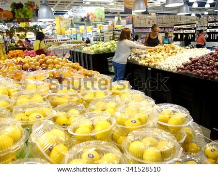 ANTIPOLO CITY, PHILIPPINES - NOVEMBER 19, 2015: Fresh fruits and vegetables on the shelves of a grocery store in Antipolo City, Philippines - stock photo