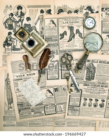 antique accessories and writing tools, vintage fashion magazine for the woman. aged paper background