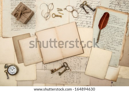 antique accessories, old letters, gift box, watch and keys. vintage nostalgic background - stock photo