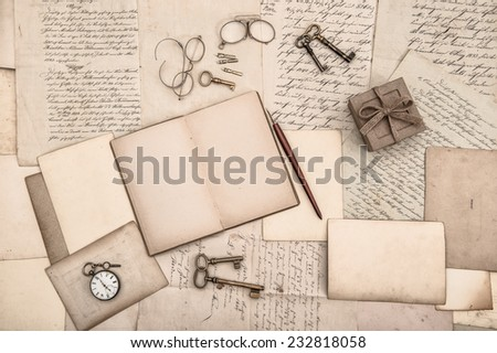 antique accessories, open book and old handwritten letters. nostalgic background - stock photo