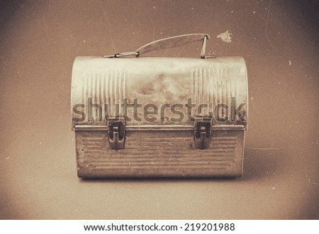 Antique aluminum lunch box.  Vintage filter with dust and scratches.  - stock photo