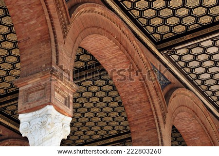 Antique archway made of bricks. Spain Square. Seville - stock photo