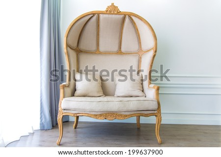 Antique armchair in white room with curtain background - stock photo