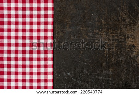 Antique baking tray with a red checkered tablecloth - stock photo