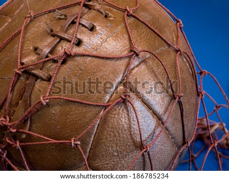 antique ball from the year one thousand nine hundred and leathers in brown, hand-sewn - stock photo