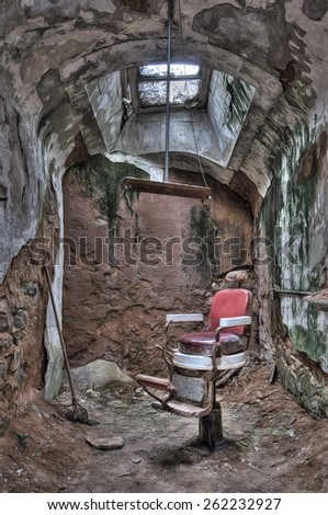Antique Barber Chair in a Cell in Eastern State Penitentiary in Philadelphia, Pennsylvania