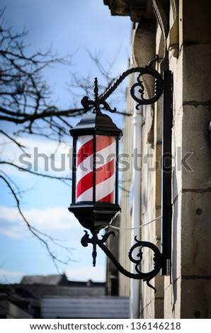 Antique Barbers Sign in England on a sunny winters day - stock photo