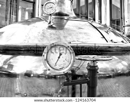 Antique Beer Factory. Old style of brewing beer. Monochrome photography. - stock photo