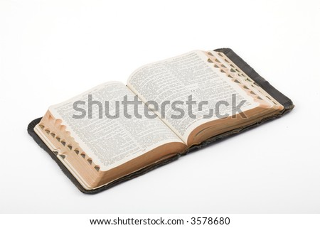 Antique Bible photographed in the studio on a white background