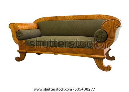 Antique Biedermeier sofa isolated with authentic fabric and wood carving