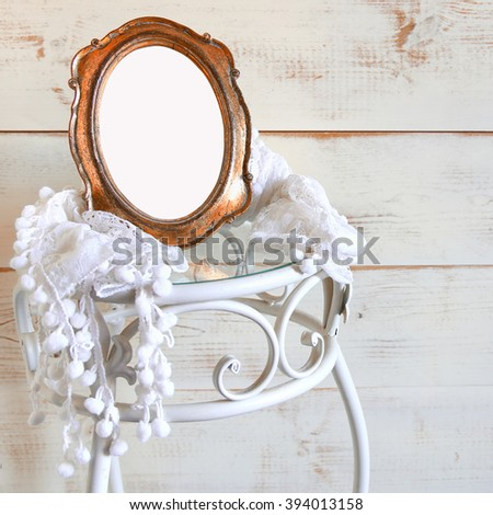 Antique blank vintage style frame and white scarf on elegant table. template, ready to put photography. vintage filtered and toned  - stock photo