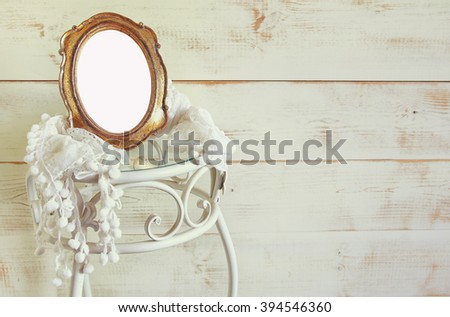 Antique blank vintage style frame and white scarf on elegant table. template, ready to put photography. vintage filtered  - stock photo