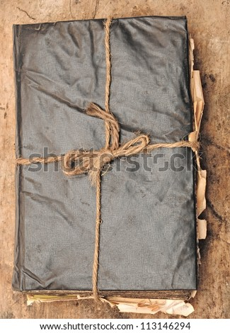 antique book and rope on wood - stock photo
