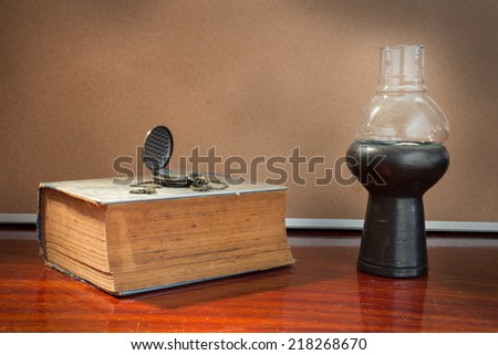 Antique book and watch with lamp.  - stock photo