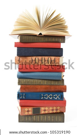 Antique book stack isolated on white background - stock photo