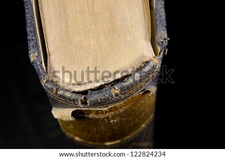 antique bookbinding from above, decay - stock photo