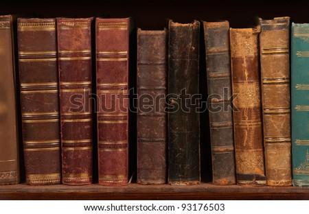 Antique books on bookshelf - stock photo