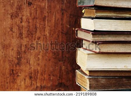 antique books on wooden shelf. - stock photo