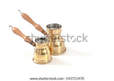Antique brass coffee brewing pans from the Middle east - stock photo