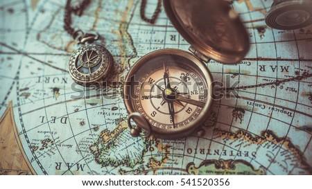 Antique Bronze Emblem Compass Mini Compass Stock Photo - Antiques us maps with compass