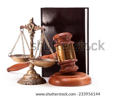 Antique bronze scales, gavel and book on white background - stock photo