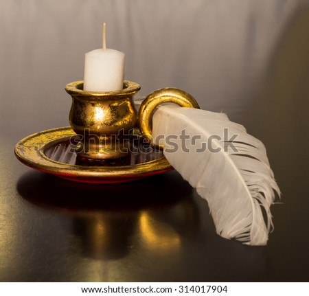 Antique Candle with a feather