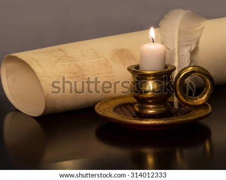 Antique Candle with a feather and parchment