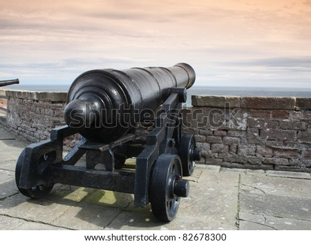 Antique cannon in the grounds of Bamburgh Castle, England