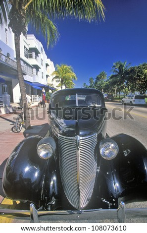 Antique car with caricature of Humphrey Bogart driving in south beach, Miami Beach, Florida - stock photo