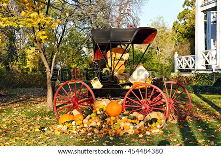 Antique carriage decorated wit colorful pumpkins - stock photo