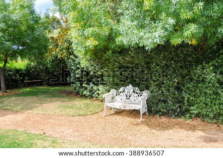 Antique cast iron bench at Amaze'n Margaret River/Antique Bench/MARGARET RIVER,WA,AUSTRALIA-JANUARY 16,2016: Cast iron bench at Amaze'n Margaret River gardens in Margaret River, Western Australia.