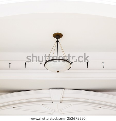 Antique ceiling lamps in modern thailand architecture - stock photo