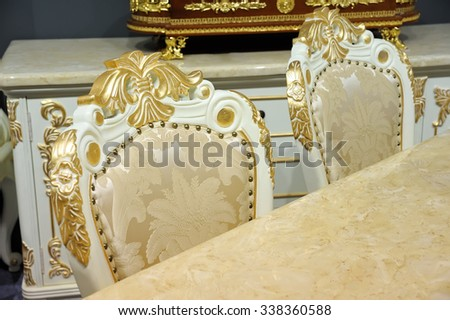 Antique chairs and a table fragment - stock photo