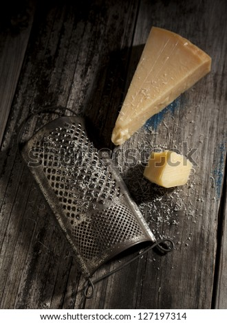 Antique Cheese Grater With Parmesan Cheese.