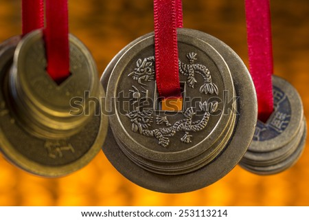 Antique Chinese coins in a hotel in Beijing in China. - stock photo