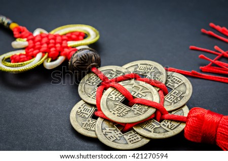 Antique Chinese coins on black background for protection and good luck