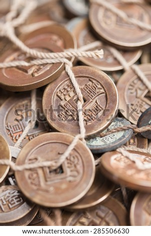 Antique Chinese coins on Panjiayuan Market, located in south east Beijing, China. - stock photo