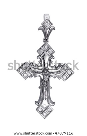 Antique christian cross isolated on white background. Handcrafted silver jewelry religious concepts