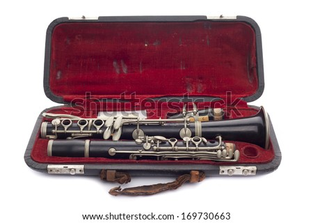 Antique Clarinet broken down in its travel case Isolated on white