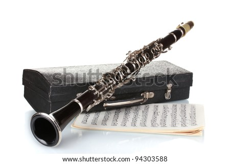 Antique clarinet, case and notebook with notes isolated on white - stock photo