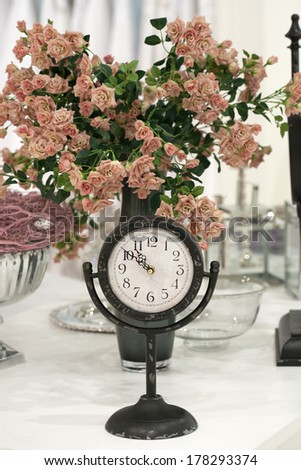 Antique clock and roses - stock photo