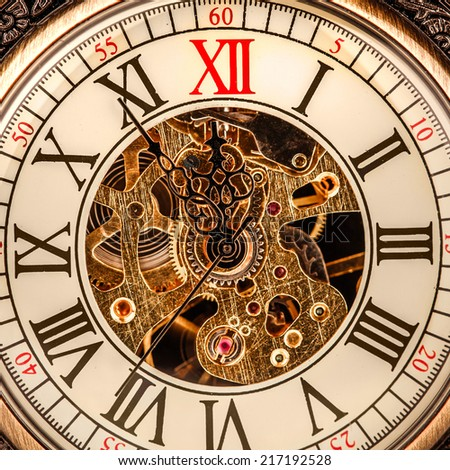 Antique clock dial close-up. Vintage pocket watch. - stock photo