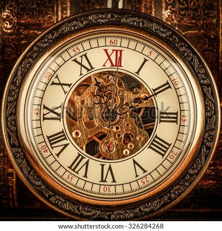 Antique clock dial close-up. Vintage pocket watch. - stock photo