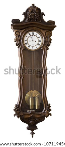 Antique clock hanging on a wall - stock photo