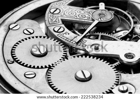 antique clock machinery, black and white photo - stock photo
